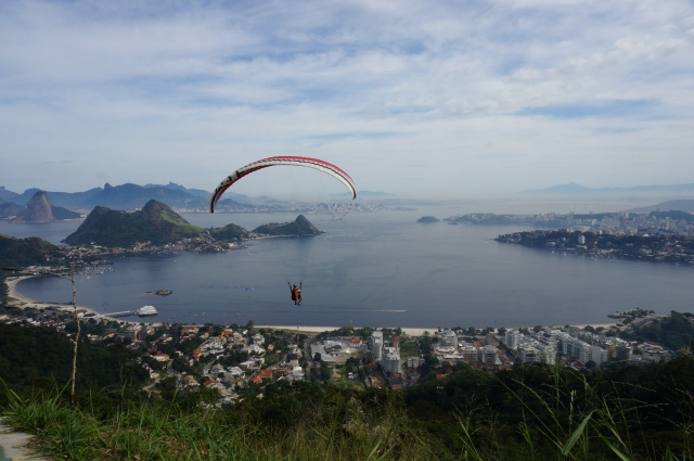 Paragliding over Niterói, with a view of Rio on the horizon.